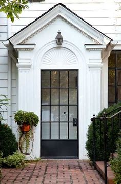 Love the paneled glass and iron door!