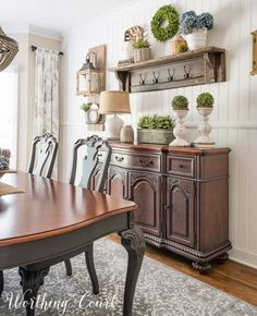 Farmhouse Dining Room Makeover - a vintage looking rug defines the space