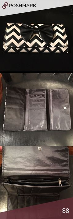 """Black and White Chevron Wallet with Bow. Adorable Black and white chevron wallet with bow. Includes lots of handy slots for cards and notes. Also includes a zipper pocket for change and a snap closure on front. Approx. 7"""" x 4. Never used. Bags Wallets"""