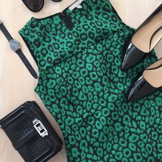 """Banana Republic Sleeveless top Gorgeous jacquard top in green and black leopard print. Material is thick and structured. Bust 16.5"""", waist 15.5"""", length from shoulder to hem 25"""" Banana Republic Tops"""