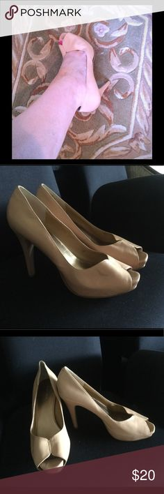 Nine West Nude Peep Toe Heels In Size 11 --Beige-tan glossy leather upper with indented seam up center vamp.  --Smooth manmade lining.  --Well-cushioned footbed.  --Hidden 1-inch platform in front, covered 4¾-inch stiletto heel.  --Textured rubber sole and heeltip.  These shoes are pre-owned, still in beautiful condition. A few faint scuffs to uppers and covered heels. Light scuffing to soles and heeltips. Nine West Shoes Heels