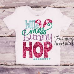 "✂ Shirt features a gorgeous, sparkly """"LITTLE MISS BUNNY HOP"""" design. Premium Glitter does NOT shed and will stay perfect wash after wash.✂ Design size will vary slightly depending on shirt size.✂ Ha"