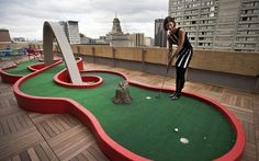 The Myth of the Cool Office: golf course on the top of a building