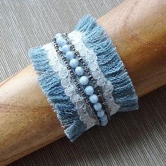 Soft faded denim blue cuff bracelet is accented with a layer of stitched ivory v. - Soft faded denim blue cuff bracelet is accented with a layer of stitched ivory vintage lace and han - Bracelet Denim, Fabric Bracelets, Cuff Bracelets, Gypsy Bracelet, Leather Necklace, Boho Necklace, Denim And Lace, Blue Denim, Textile Jewelry