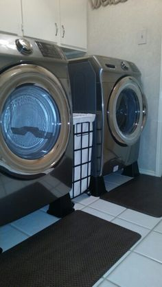 Lift front loader washing machine and dryers with bed risers. Garage Laundry Rooms, Bed Risers, Laundry Pedestal, Garage Organization, Organizing Ideas, Washing Machine And Dryer, House Cleaning Tips, Washer And Dryer, Clean House