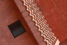 A red tile roof makes a house stand out from the ordinary. For some homeowners, the red tile is just one component of a vibrantly painted color theme. Other home designers prefer to paint the balance ...