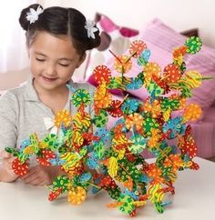 Connectagons -- This award-winning creative building set offers limitless opportunity for fun and challenge! Build in any direction with these bright colors, patterns, and shapes! #STEM #gift #ideas #holiday #shopping #building