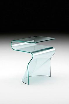 Made with simplicity, Toki by Fiam is a refined furnishing accessory. This monolithic bedside table is made of 10 mm curved glass for a moderately tasteful decor. Available in various finishes: Transparent glass, extralight glass, smoked glass, bronze glas, black 95 glass. #bedside #glass #toki #fiam #arredaremoderno Curved Glass, Modern Glass, Modern Bedroom, Bedside, Different Colors, Mirror, Table, Bronze, Design