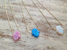 Check out this item in my Etsy shop https://www.etsy.com/listing/209668662/opal-hamsa-necklace-hamsa-necklace-hamsa