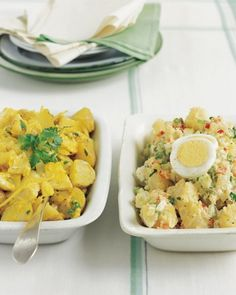 Curried Potato Salad - Diced red bell peppers, celery, onion, and cornichons add crunch to this classic potato salad. You can use either homemade mayonnaise or your favorite prepared brand for this dish. This recipe makes enough for a dozen people, perfect for bringing to a potluck.