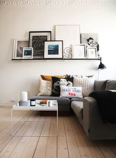 Floating Shelf Gallery Wall--I want a layered look with the artwork in my living room