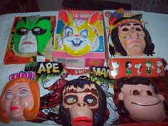 Vintage Halloween Masks & Costumes 60's 70's  plastic masks! LOL! Omg! Remember them elastics snapping that held the on? and they would slip so the nose holes were up by your eyes and you couldn't breathe!! We didn't care - we were getting candy!! Lol!! My sister and I had a couple of those shown!!
