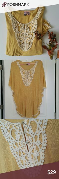 Love On A Hanger Mustard Boho Blouse This is a beautiful vintage style mustard Boho blouse by Love On A Hanger!   Beautiful crochet pattern on the bust with pearly buttons & fringe along the butterfly sleeves & hem. Stretchy waistline. love on a hanger Tops Blouses