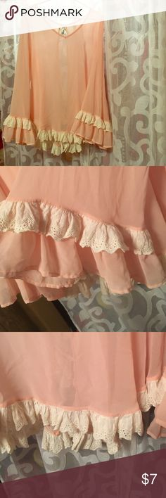 Beautiful ruffle sleeve blouse with lace detail Has ruffles on sleeves, bottom, and down the back. Precious! Doesn't have a tag size, but I would say fits a large. Tops Blouses