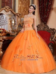Classical Orange Quinceanera Dress Sweetheart Tulle Appliques Ball Gown- http://www.fashionos.com  http://www.facebook.com/fashionos.us  All eyes will definitely be on you in this wonderful beaded appliques-encrusted shimmering quinceanera dress.Its flared, floor-length skirt features a diaphanous outer layer that is studded with magnificently chic lace accents. Meanwhile, the fitted bodice is framed by a sweetheart neckline and dropped waistline.