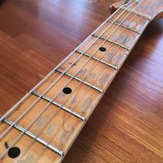 A Fender Telecaster maple fretboard.....much like a well traveled road