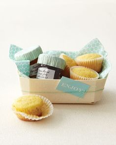 """Offer guests a morning-after meal for the wedding favor. Arrange miniature jams and corn muffins in a basket lined with napkins, then add a clip art tag.The Details: Bonne Maman preserves (chefswarehouse.com); Panibois """"Prince"""" baking basket B2AG (technobake.com)."""