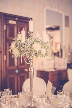 wroxall abbey wedding flowers vintage glamour candelabra with pearls centrepiece. See more of our floral designs at www. Voted Best Wedding Florist in ENGLAND in The Wedding Industry Awards. Vintage Glamour Wedding, Vintage Wedding Flowers, Beach Wedding Flowers, Glamorous Wedding, Sparkle Wedding, Luxury Wedding, Candelabra Wedding Centerpieces, Pearl Centerpiece, Flower Centerpieces