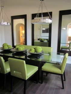 hang mirrors in multiples to fill large wall and create art - dining room