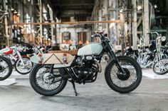 Custom CB350 and Winner of a One Show Award. Build By Kick Start Garage for World's Greatest Co | Custom Motorcycle skateboard Rack for Transporting your skateboard.