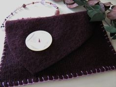 Purple Felted Knit Wristlet with Vintage Button Closure and Beaded Strap. $18.00, via Etsy.