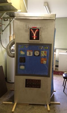 Our time machine for Bible Blast to the Past VBS - stackable washer/dryer box painted silver and phone booth door cut out on the side, fully equipped with oversized iPhone screen, flux capacitor and time circuit board.