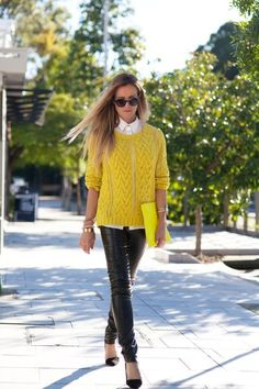 Street style yellow sweater and leather pants.