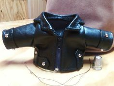 This is a hand made black leather coat for a prayer teddy bear. He was going to the hospital for a motorcycle accident victim. Notice the needle and thread, for size!