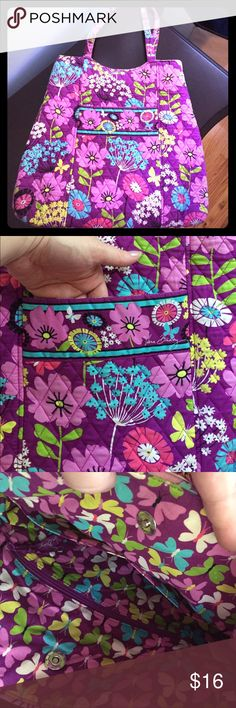 Vera Bradley tote in Flutterby Beautiful cheery butterfly and floral design. Snap closure with 3 interior pockets and additional front pocket as well. Easily holds tablet and laptop plus other essentials. Light wear on bottom corners and straps. Very good used condition. I upgraded to larger bag to accommodate my daughters stuff (toddlers 😜) and this bag is just being wasted in my closet. Machine washable 👍🏻 Vera Bradley Bags Totes