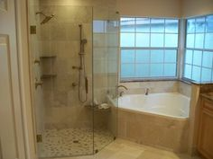 master bath with granite countertops, stand-up shower with a shelf