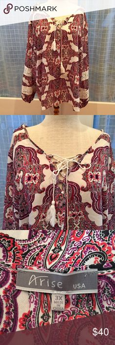 """NWOT! Paisley Blouse NWOT! Paisley print in hues of pink highlight this scoop neck top that has a rope-like string with tassels. Open weave lace sections on the arms. Elastic cuffs. Cute and fun for any occasion. PTP 27"""" Length 28"""". Boutique Tops Blouses"""
