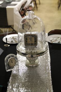 """""""Time to Celebrate"""" Theme as vintage clocks were spray painted and placed on tables in various places."""