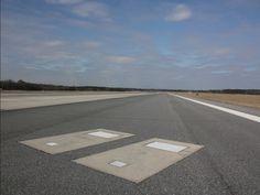 Gravemarkers are visible next to the runway at Savannah-Hilton Head International Airport.