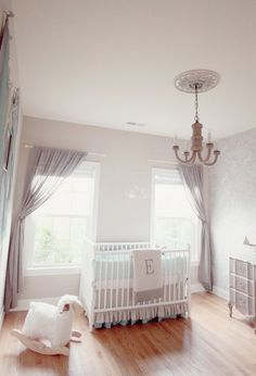 Soothing mint + gray nursery fuses traditional and modern just by adding in gray