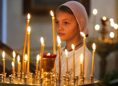 Russia - A girl attends an Orthodox service at St. Catherine in remembrance of the victims of the Sept. 11, 2001 terror attacks, Moscow