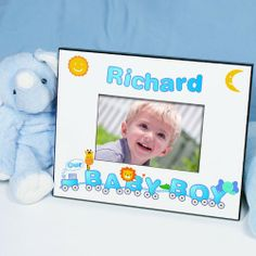 "Personalized Baby Boy Picture Frames. Welcome Aboard The Animal Train Express. This adorable Choo-Choo train is ready to deliver joy and fun-filled adventures to your baby boy's day. Show off your special delivery with our Personalized Baby Boy Picture Frame. A truly one-of-a-kind baby keepsake the entire family will love. Your Custom Animal Train Picture Frame measures 8"" x 10"" and holds a 3.5"" x 5"" or 4"" x 6"" photo. Easel back"