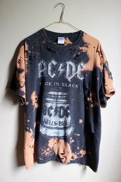 This shirt is a one of a kind, each splattered shirt is different.  This one is a AC/DC Back in Black tee , all cotton.  Splatter bleach and