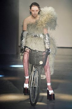 LOVE that Vivienne Westwood had a bike (w/ basket) on the runway #cycling