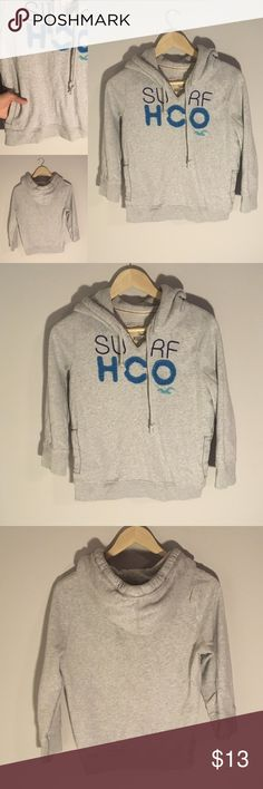 Hollister Women's Grey 3/4 Sleeve Hoodie This old school Hollister hoodie is in excellent condition! The 3/4 sleeves make it perfect for spring and summer. Wear with your favorite leggings or shorts! The logo on the front is stitched on so there is some dimension. The back is blank. Plus, there are pockets on both sides to hold all your essentials! Hollister Tops Sweatshirts & Hoodies