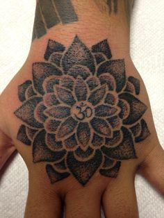 Lotus tattoo done with a stippling style by Tabitha Hammercheek at Professional Ink Tattoo Studio