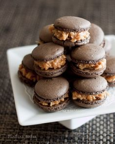 Samoa Macarons  A rich, crisp on the outside, chewy on the inside chocolate macaron filled with caramel and toasted coconut. The flavors of a Girl Scout Samoa cookie dressed up for a macaron party.