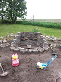 Fire Pit...wall to block where to typical wind comes thru