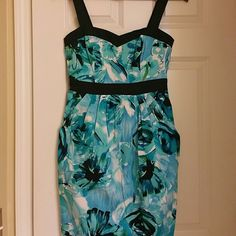 Blue Floral dress So cute! Never wore it.  Has a little stretch to it. B.Smart Dresses