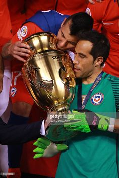 Gary Medel and Claudio Bravo of Chile celebrate with the trophy after winning the championship match between Argentina and Chile at MetLife Stadium. Cardiff, Claudio Bravo, Metlife Stadium, World Football, The Championship, Soccer, America, Pictures, Sport
