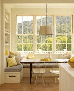 This would be a great breakfast nook for where our dining room is now. Love the built-in shelves instead of a plain wall.