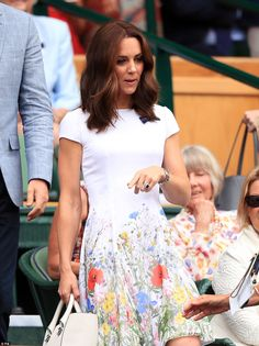 The Duchess was the picture of summery perfection in a white frock with a vibrant floral p...
