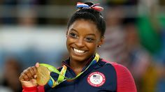 Biles' crush and No. 1 fan, Zac Efron, said he'll 'be with her in spirit.'