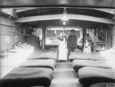 Interior of a ward in a hospital barge near Aire, 14 February 1918.