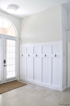 home remodeling DIY board and batten wainscotting panels with hooks for entryway or mudroom Entryway Hooks, Entryway Decor, Entryway Cabinet, Grand Entryway, Entryway Stairs, Entrance Foyer, Entryway Furniture, Entryway Ideas, Home Improvement Projects