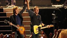 Bruce Springsteen and Paul McCartney performs in London at Hard Rock Calling 2012.